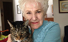 heritage society member with her cat